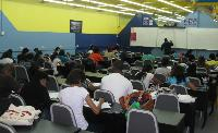 Lecturer (Mr. Imran Hosein) and students at work during study school (MA2)