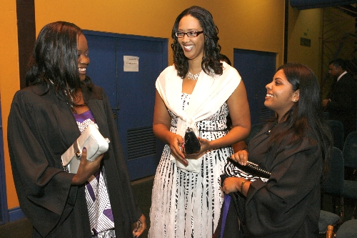 University of Greenwich Bachelor's Degree Valedictorian, Sheena Sylvester, (centre) shares a moment with two of her classmates