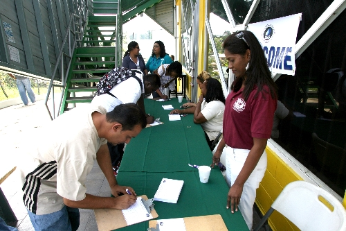 Visitors register to view booths at San Fernando Open Day