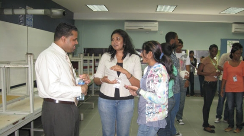 SBCS' Chief Financial Officer, Kevin Ruiz, chats with students during the Networking session