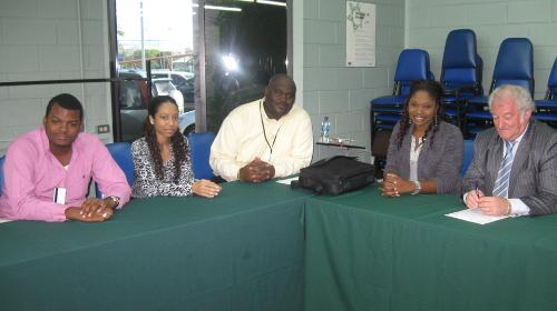 Mr Brooks meeting with Keon Jeffery, Lynelle Fyzool, Derron Dickson, and Delicia Patterson - students at the Champs Fleurs Campus