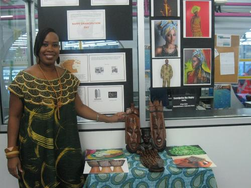 SBCS library staff poses with the  Emancipation Day display at the San Fernando campus