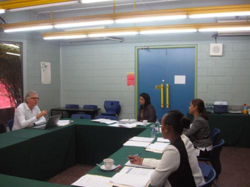 UOLei's Tutor, Dr. Roger Dickinson, and SBCS Corporate Education Centre team in an Administrative & Academic Meeting