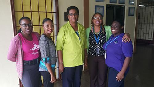 Trincity Campus staff with the Principal of Dinsley Government Primary School