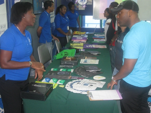 visitors receiving information from the MBA booth