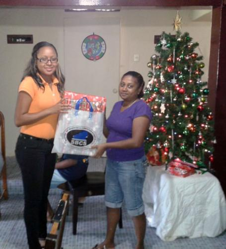 Caretaker Debra Mc Kenzie receives Christmas gifts