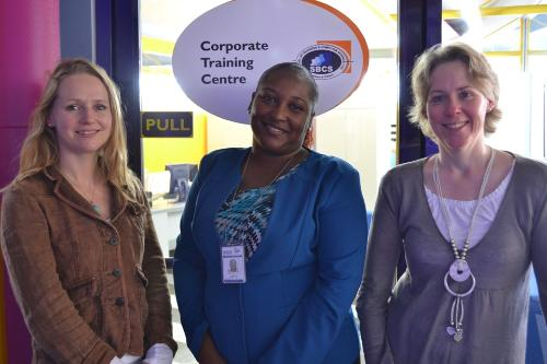 from left to right - Ms. Gemma Gwynne-Stevenson, EBS Quality Manager, Ms. Selina Lewis, Supervisor of Academic and Administrative Support and Ms. Sally Mac Leod at the entrance to our Corporate Training Centre Department