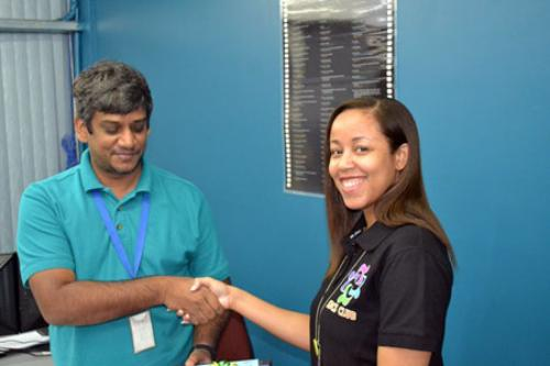 SBCS Club Event Co-ordinator distributes a Father's Day token to a staff member