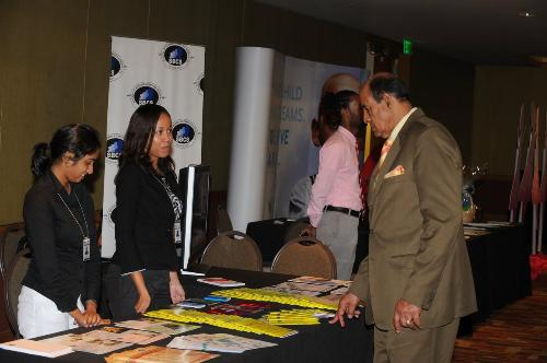 Minister of Education, Dr. Tim Gopeesingh visits the SBCS booth