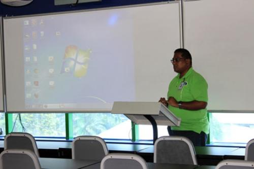 Senior Course Administrator, Mr. Dipnarine Ramlochan delivers his Welcome Address at SBCS San Fernando