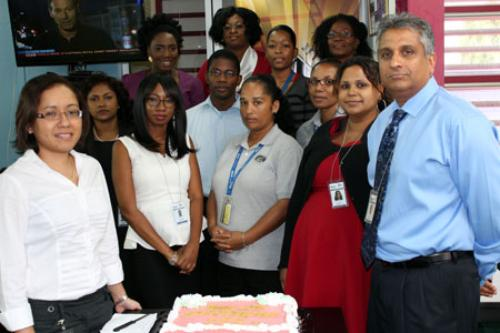 POS Campus staff poses with Executive Director, Dr. Robin Maraj