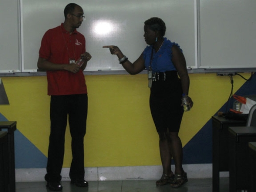 Presenters Jameela Ollievierre and Jason Burnett engaged in a skit.