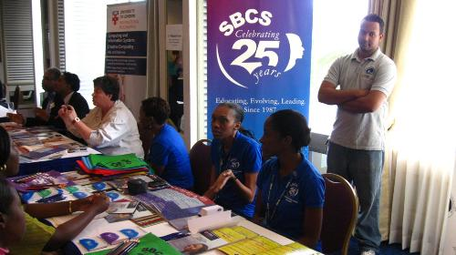 The SBCS team consisting of staff, alumni, and current students along with Dr Maggie Cooper, Director of Computing Programmes provide information to prospective students.