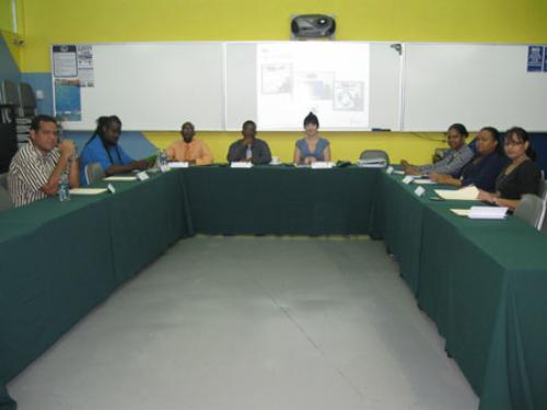 Ms. Abigail Smith (centre) with staff and lecturers.
