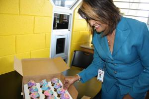Senior Manager, San Fernando Campus - Mrs. Terry Amirali-Rambharat sets up the commemorative treats.