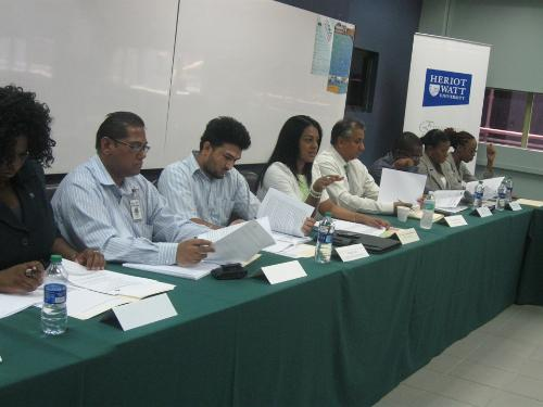 Senior Manager, Corporate Education Centre, Mrs. Jenelle Alexander-Ramkissoon reviews the minutes of the last meeting.