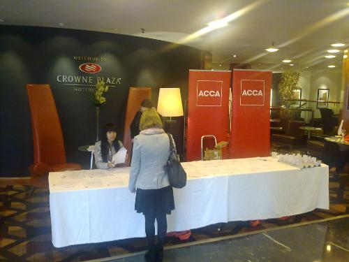 ACCA Staff assisting with conference registration