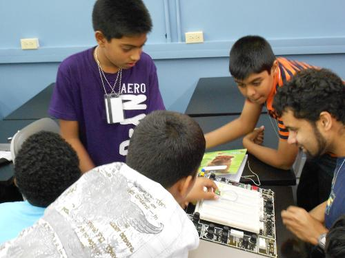Kids learning how to build circuits.